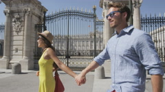 Couple walking in Madrid by Royal Palace in Spain - Spanish landmarks Stock Footage