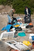 Clearing a Beach rubbish Stock Photos