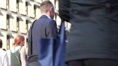 Business people crossing road Stock Footage