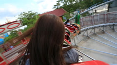 Roller coaster womam riding POV Stock Footage