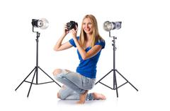 Woman with camera isolated on the white Stock Photos