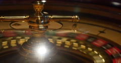 A 4K close shot of a casino roulette in motion Stock Footage
