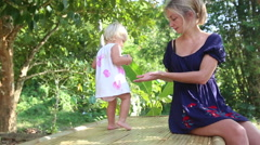 Little blonde girl play with  her mother Stock Footage