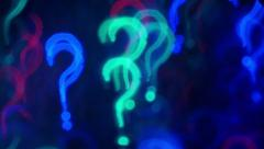 Question marks. Out of focus lights background. 4K UHD 2160p footage. Stock Footage