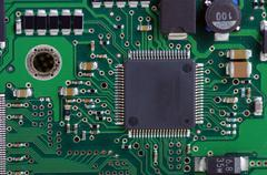 Green computer board with chips and components. Stock Photos