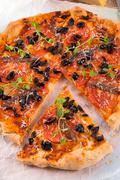 olive anchovy pizza - stock photo