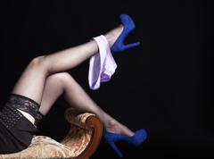 Stock Photo of slender legs lying girl in black stockings with panties