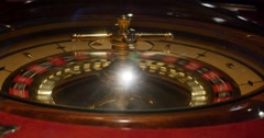 Front shot of a casino roulette in motion - stock footage