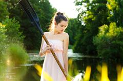 Girl with a paddle Stock Photos