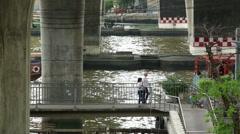 Ferries on Chan Phraya river under road bride Bangkok Stock Footage