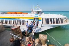 passengers get off hydrofoil from Saigon in Vungtau - stock photo