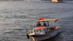 Motor boat with Turkish Flag near Maidens Tower - stock footage
