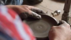 Man making traditional pottery in the old Romanian way Stock Footage