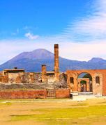 Ruins of Pompeii and volcano Mount Vesuvius - stock photo