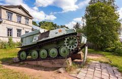 Soviet light semi armored tracked artillery tractor AT-P  as monument - stock photo