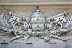 Papal coat of arms at St Peter's Church in Parma, Italy Stock Photos