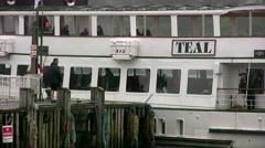 Windermere steamer MV Teal pivoting into mooring position at Bowness Stock Footage