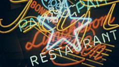 Amsterdam 1963: shop neon signs Stock Footage