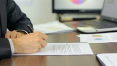 Businessman signing documents, confirm   Stock Footage
