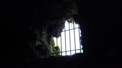 Barred up hole in cave creating prison 4k Stock Footage
