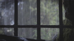 Behind medieval Prison bars with rain outside 4k Stock Footage