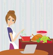 Housewife looking in laptop during cooking soup at home kitchen Piirros