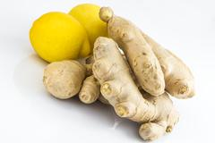 Ginger roots with lemons Stock Photos