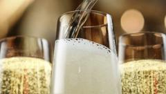 Opening a champagne. New Year's party pouring champagne - stock footage