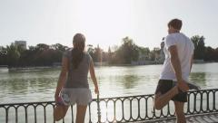 Fitness runners stretching thigh exercise in park - Running couple stretches Stock Footage
