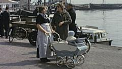 Holland 1963: mothers talking in front of the Ocean - stock footage