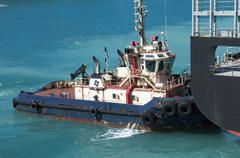 Tugboat assistance on sea  - stock photo