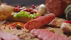 Assortment of Meat products on a wooden board. - stock footage