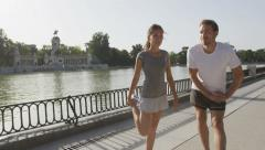 Running people stretching out in city park Stock Footage
