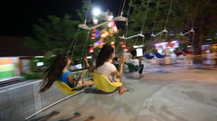 Swing ride at fair amusement park Stock Footage