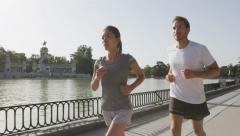 Sport runners running in Madrid El Retiro park -  healthy lifestyle Stock Footage