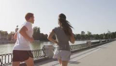 Jogging runners running in Madrid El Retiro park - SLOW MOTION Stock Footage