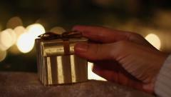 Hands of woman closing Christmas gift box HD Stock Footage