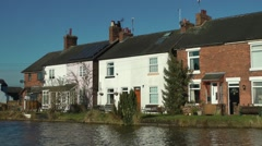 Canal side cottages deep blue sky Trent and Mersey rural Stock Footage
