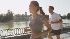 Couple jogging running in Madrid El Retiro park - Exercising in SLOW MOTION Stock Footage