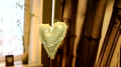 Handmade linen heart decoration in the interior apartments Stock Footage