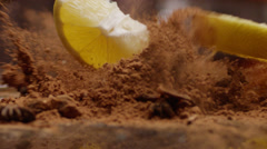 Lemon falling into cacao slow motion Stock Footage