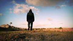 Man Walks On Hilltop Stock Footage