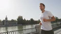 Jogging man running in city park El Retiro Madrid - healthy active lifestyle Stock Footage