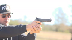 Policeman shooting an automatic 9mm caliber  pistol. Stock Footage