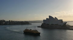 Australia Sydney Opera House with two ferries passing Stock Footage