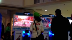 Wii store stuff demonstrates car racing game Stock Footage