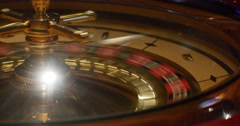 Close up shot of a casino roulette and a ball in motion Stock Footage