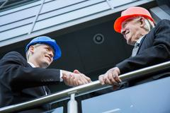 Stock Photo of Civil engineers shaking hands