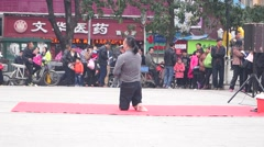 A disabled man begging in singing performance Stock Footage