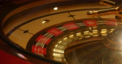 Close up shot of a casino roulette in motion Stock Footage